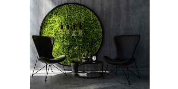 round grass circle with black chairs and table