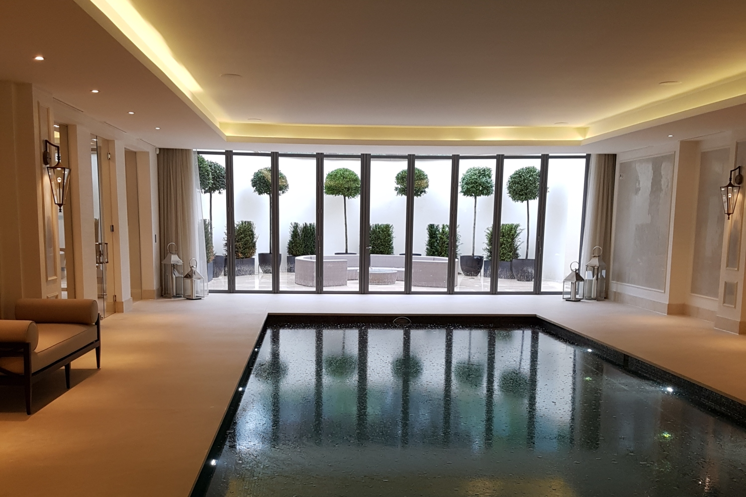 Swimming Pool with Absolute Crema Marfil Surround – Kinorigo