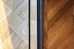 marble floor tiles and wooden parquet flooring