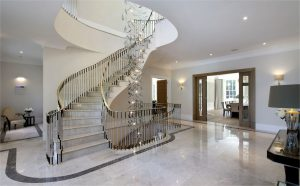 marble spiral staircase with light feature