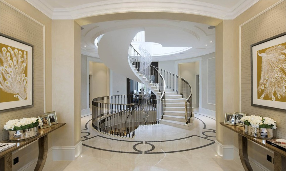 entrance with spiral staircase and marble flooring