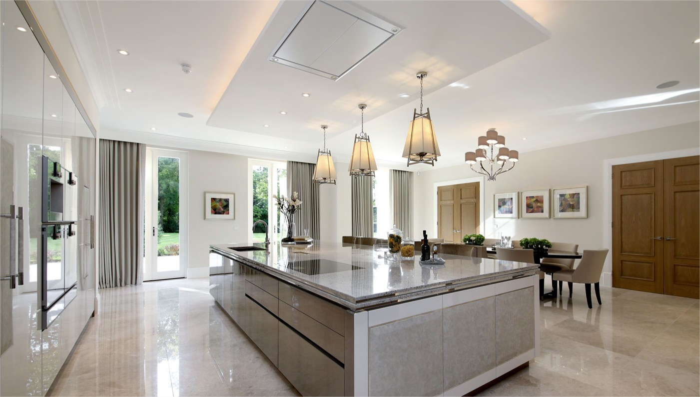 large kitchen dining area with kitchen island and light features