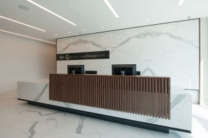 marble reception desk with wooden panels