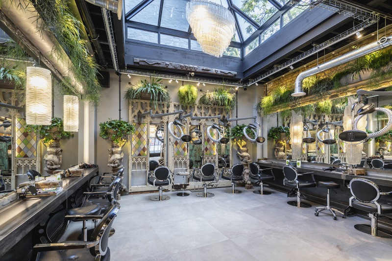 hairdressers with chairs around the edge