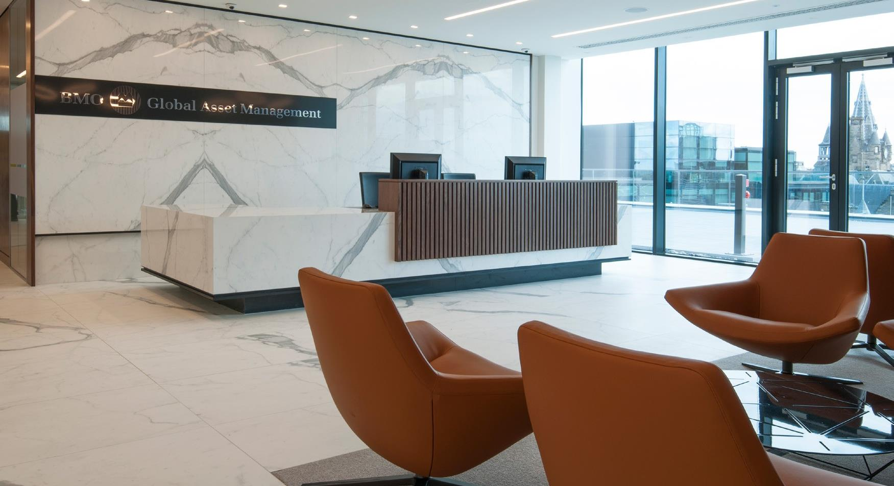 orange leather chairs in reception area
