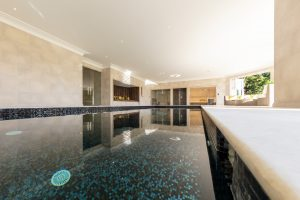 blue pool tiles for big indoor pool