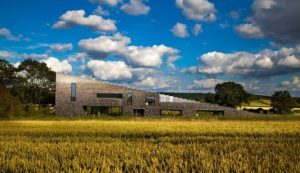 flint house in open field with blue skies