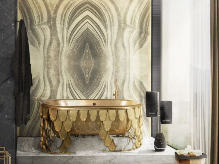 gold detailed bath against statement wall