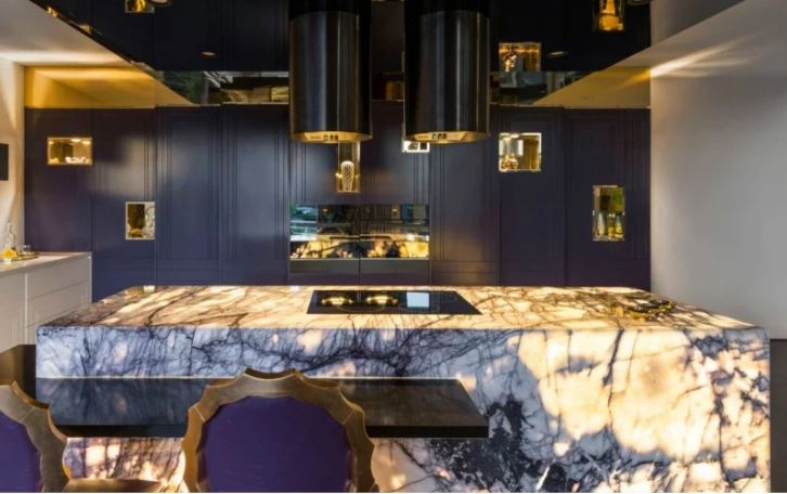 purple and gold kitchen area with marble kitchen island