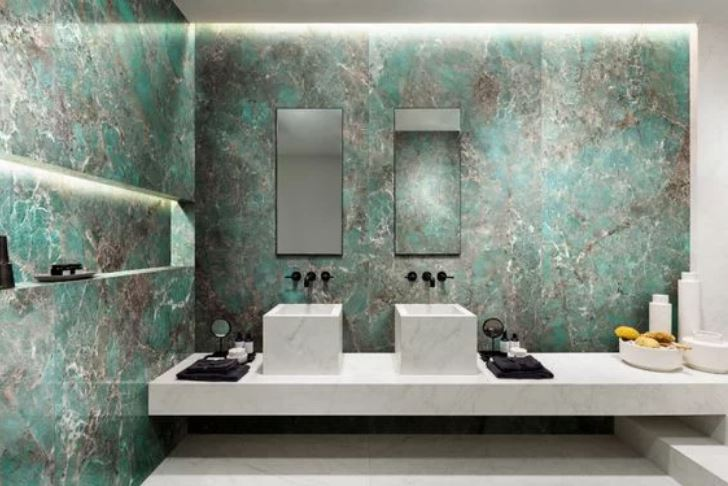amazonite wall in bathroom with white basins and mirrors