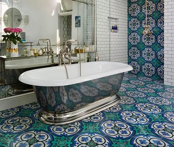 patterned tiles in bathroom with metal bathtub