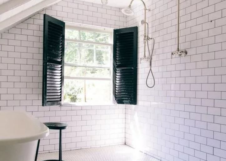 white tile wet room with barn windows